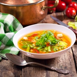 bowl of vegetable soup on wooden table
